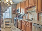 The fully equipped kitchen is ideal for preparing home-cooked meals.