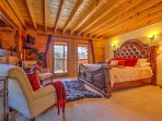The master bedroom on the second floor features a queen bed and private balcony.
