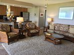 Tasteful, luxurious new furniture graces the living room, dining alcove. Enjoy the view in comfort.