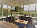 The pretty sunroom with it's panoramic and uninterrupted views of Loch Leven.