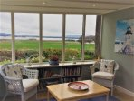 The sunroom is a favourite amongst guests! There are games and books there for all to enjoy too.