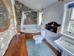 The bathroom is on the ground floor and has a shower over the corner bath
