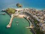 Tenby just round the bay with sandy beaches, shops & restaurants