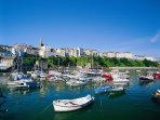 Tenby is a short car journey with its colourful houses alongside the harbour.