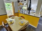 Kitchen diner, includes a dining table and 4 chairs with yellow décor