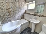 The smart family bathroom has a shower over the bath