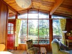 Large windows in the living room allow plenty of natural light
