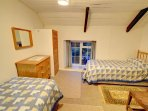 The twin bedroom has comfortable beds and plenty of room