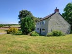This extremely spacious and very old five-bedroomed farmhouse stands in its own grounds and is surrounded by 50 acres...
