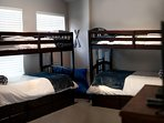 Bedroom with 2 Twin bunk bed sets & 2 Twin Trundles underneath