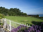 The front sea facing garden overlooks a communal green, where rabbits frolic in the morning
