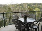 Relax on your private covered balcony 80 ft from Table Rock Lake. Gas Grill too!