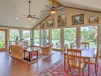 This home features vaulted ceilings and wall-to-wall windows!