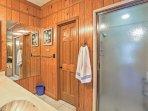 This en-suite bathroom features a walk in shower.