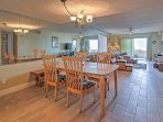 Enjoy home-cooked meals at the dining table set for 4.