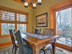 Gather around the 4-person dining table to enjoy your meals.
