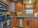 Stainless steel appliances and granite countertops add luxury to every meal.