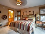 The master bedroom offers a king-sized bed and access to a private balcony.