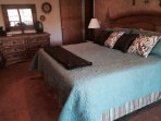 King bed in bedroom on lower level with a 36' TV.  Atrium doors lead to main deck.