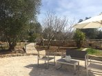 The terrazza and seating area for the trullo with the pool beyond.