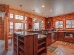 Large kitchen with granite bar
