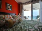 One of two master ensuite, ultra conformable bed, plush linens, and an ocean view. Terrace access.