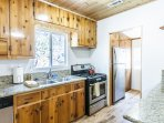 Kitchen with stainless appliances & granite