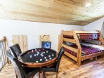 Bunk room has combo bumper pool & poker table