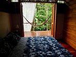 Master Bedroom looking out to Veranda and jungle.