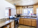 Spacious kitchen with stainless appliances & granite