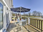 Enjoy your morning coffee outside on the deck at the dining table with a sun umbrella.