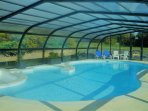 Brand new heated covered swimming pool with jacuzzi!