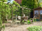 Walled garden has bbq area and summer house