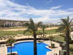 Stunning views across championship golf course and beautiful communical pool from  spacious balcony