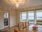 Sun room with sea view across to Mull of Oa and village of Port Charlotte