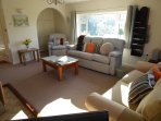 Lounge, 8 comfortable seats, small office area/printer, double doors  to the dining room