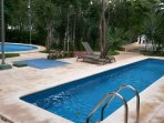 There are two pools within steps of the house as well as a lounge area