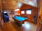 Game room w/pool table, arcade machine and 42' Hd TV + seating area