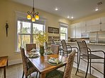 Gather with friends and family around the charming 4-person dining room table for family games and delicious homemade...
