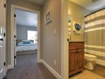 Through the archway off the kitchen lies two bedrooms with a full bathroom in between.