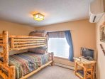 Kids will love sharing this bedroom with a twin-over-full bunk bed!