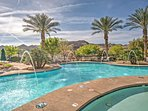 Relax poolside and enjoy the surrounding views of mountains and soaring palm trees.
