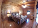 Master Bedroom w/ King size bed and 32' Hd TV located on main level