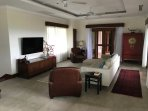 Family living room with large flat screen TV, AppleTV and access to international TV channels