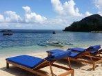 Private beachfront and sunbathing area.