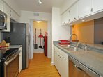 Kitchen w Stainless Appliances full size Washer /  Dryer