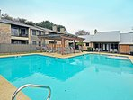 Pool w Sundeck along w bbq's