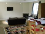 Pull down double bed and a fold out sofa bed, studio type layout. Fire place for those cosy evenings