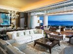 Grand Luxxe living area with panoramic electric glass wall