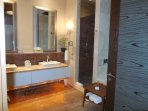 All marble bath with jetted soaking tub and separate large shower